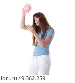 Купить «Young woman trying to get money from her piggy bank, isolated on white backgroun», фото № 9362259, снято 26 марта 2019 г. (c) PantherMedia / Фотобанк Лори