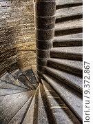 Купить «Каменная старинная винтовая лестница», фото № 9372867, снято 2 августа 2015 г. (c) Юрий Плющев / Фотобанк Лори