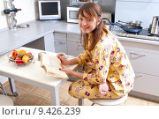 beautiful young woman is reading a book and has a breakfast. Стоковое фото, фотограф Raykin Dmitriy / PantherMedia / Фотобанк Лори