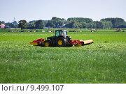 Купить «Farmer on tractor mowing grass in summer», фото № 9499107, снято 15 июля 2018 г. (c) PantherMedia / Фотобанк Лори