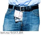 Купить «detail of a jean trousers denim with money indise», фото № 9517391, снято 27 июня 2019 г. (c) PantherMedia / Фотобанк Лори