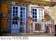 Декоративные украшения на балконе (2015 год). Стоковое фото, фотограф DMITRII KUDASOV / Фотобанк Лори