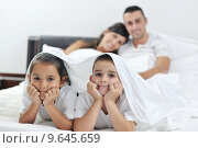 Купить «happy young Family in their bedroom», фото № 9645659, снято 2 апреля 2020 г. (c) PantherMedia / Фотобанк Лори