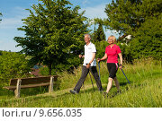 Купить «happy elderly couple nordic walking in summer», фото № 9656035, снято 11 декабря 2018 г. (c) PantherMedia / Фотобанк Лори