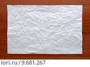 Купить «Wrinkled White paper attach on Wooden Board», фото № 9681267, снято 22 марта 2019 г. (c) PantherMedia / Фотобанк Лори