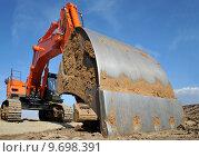 Купить «scoop construction site dredger baggern», фото № 9698391, снято 20 марта 2019 г. (c) PantherMedia / Фотобанк Лори