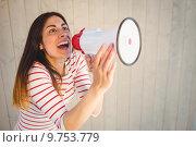 Pretty hipster shouting through megaphone. Стоковое фото, агентство Wavebreak Media / Фотобанк Лори