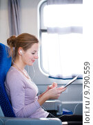 Купить «Young woman using her tablet computer while traveling by train», фото № 9790559, снято 17 июля 2019 г. (c) PantherMedia / Фотобанк Лори
