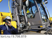 Купить «driver standing in fron of large bulldozer cabin», фото № 9798819, снято 19 октября 2019 г. (c) PantherMedia / Фотобанк Лори