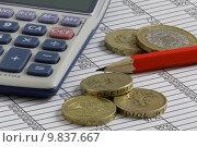 Купить «Calculator & Coins on a Spreadsheet», фото № 9837667, снято 20 сентября 2018 г. (c) PantherMedia / Фотобанк Лори