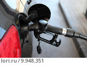 Gas station pump nozzle in the cars fuel tank. Стоковое фото, фотограф Philip Lange / PantherMedia / Фотобанк Лори