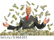 Купить «Businessman surrounded by dollar bills isolated against a white background», фото № 9964651, снято 16 декабря 2017 г. (c) PantherMedia / Фотобанк Лори