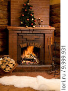 Купить «Photo of fireplace with firewood and warm white fur near by», фото № 9999931, снято 19 ноября 2017 г. (c) PantherMedia / Фотобанк Лори