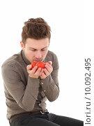 Купить «Vertical portrait of man with tomatoes», фото № 10092495, снято 22 марта 2019 г. (c) PantherMedia / Фотобанк Лори