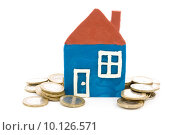 Купить «house and coins over a white background», фото № 10126571, снято 31 марта 2020 г. (c) PantherMedia / Фотобанк Лори