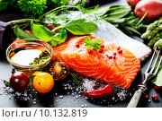 Купить «Филе лосося, соль, ароматные зелень и специи на черном столе», фото № 10132819, снято 5 июня 2014 г. (c) Наталия Кленова / Фотобанк Лори