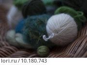 Купить «Closeup of soft green and white wools on basket weave», фото № 10180743, снято 21 мая 2019 г. (c) PantherMedia / Фотобанк Лори
