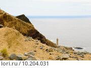 Купить «Lighthouse at Volcano dos Capelinhos», фото № 10204031, снято 17 июля 2019 г. (c) PantherMedia / Фотобанк Лори