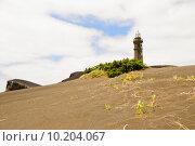 Купить «Lighthouse at Volcano dos Capelinhos», фото № 10204067, снято 17 июля 2019 г. (c) PantherMedia / Фотобанк Лори