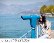 Купить «Woman is looking through spyglass», фото № 10221359, снято 26 мая 2018 г. (c) PantherMedia / Фотобанк Лори
