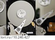 Купить «Three opened Hard drives isolated on white background», фото № 10240427, снято 19 октября 2019 г. (c) PantherMedia / Фотобанк Лори