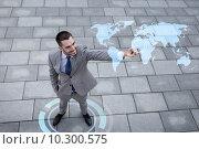 Купить «smiling businessman with world map projection», фото № 10300575, снято 19 августа 2014 г. (c) Syda Productions / Фотобанк Лори
