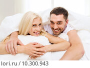 Купить «happy couple in bed at home», фото № 10300943, снято 6 июня 2015 г. (c) Syda Productions / Фотобанк Лори