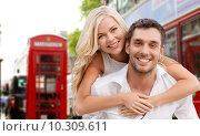 Купить «happy couple hugging over london city street», фото № 10309611, снято 14 июля 2013 г. (c) Syda Productions / Фотобанк Лори