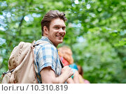 Купить «group of smiling friends with backpacks hiking», фото № 10310819, снято 25 июля 2015 г. (c) Syda Productions / Фотобанк Лори