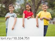 Купить «Cute pupils showing large poster», фото № 10334751, снято 7 июля 2015 г. (c) Wavebreak Media / Фотобанк Лори