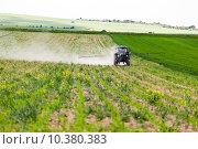Купить «Tractor spraying, agriculture», фото № 10380383, снято 14 декабря 2018 г. (c) PantherMedia / Фотобанк Лори