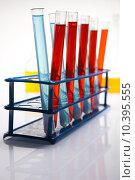 Купить «Laboratory flasks with fluids of different colors », фото № 10395555, снято 16 октября 2018 г. (c) PantherMedia / Фотобанк Лори