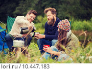 Купить «group of smiling friends cooking food outdoors», фото № 10447183, снято 31 августа 2014 г. (c) Syda Productions / Фотобанк Лори