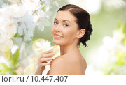 Купить «woman with soap bar over cherry blossom background», фото № 10447407, снято 6 января 2013 г. (c) Syda Productions / Фотобанк Лори