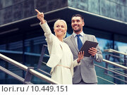 Купить «smiling businessmen with tablet pc outdoors», фото № 10449151, снято 19 августа 2014 г. (c) Syda Productions / Фотобанк Лори