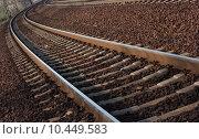 Купить «A pair of railway tracks in a bend», фото № 10449583, снято 12 декабря 2017 г. (c) PantherMedia / Фотобанк Лори