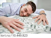 Купить «happy businessman with heap of money in office», фото № 10449823, снято 18 июня 2015 г. (c) Syda Productions / Фотобанк Лори