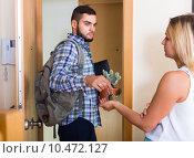 Купить «Young couple separating after quarrel», фото № 10472127, снято 27 марта 2019 г. (c) Яков Филимонов / Фотобанк Лори