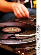 Купить «DJ playing music from turntable», фото № 10534959, снято 25 января 2020 г. (c) PantherMedia / Фотобанк Лори