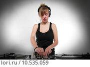 Купить «Young girl DJ mixing music», фото № 10535059, снято 25 января 2020 г. (c) PantherMedia / Фотобанк Лори
