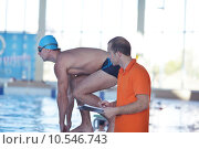 Купить «Happy muscular swimmer wearing glasses and cap at swimming pool and represent health and fit concept», фото № 10546743, снято 25 июня 2019 г. (c) PantherMedia / Фотобанк Лори