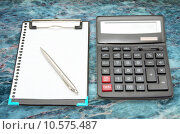 Купить «calculator and pen on a marble background», фото № 10575487, снято 17 июля 2019 г. (c) PantherMedia / Фотобанк Лори
