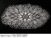 Купить «Crocheted lace napkin», фото № 10597687, снято 22 июля 2015 г. (c) Ярочкин Сергей / Фотобанк Лори