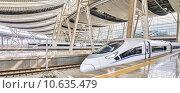 Купить «Современный высокоскоростной поезд на станции», фото № 10635479, снято 23 мая 2015 г. (c) Vitas / Фотобанк Лори