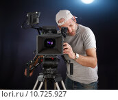 Купить «cameraman working with a cinema camera», фото № 10725927, снято 24 мая 2018 г. (c) PantherMedia / Фотобанк Лори