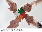 Купить «Group of business people assembling jigsaw puzzle», фото № 10732955, снято 21 сентября 2019 г. (c) PantherMedia / Фотобанк Лори