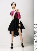 Купить «Tendency. Glamorous Fashion Model in Modern Clothes posing in Studio», фото № 10751015, снято 21 мая 2018 г. (c) PantherMedia / Фотобанк Лори