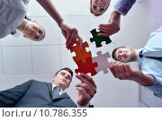 Купить «Group of business people assembling jigsaw puzzle», фото № 10786355, снято 21 сентября 2019 г. (c) PantherMedia / Фотобанк Лори