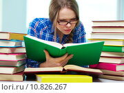 Купить «Diligent student being absorbed in studying», фото № 10826267, снято 18 марта 2018 г. (c) PantherMedia / Фотобанк Лори