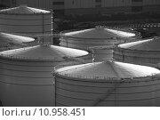 Купить «Monochrome oil tank in cargo service terminal », фото № 10958451, снято 17 декабря 2018 г. (c) PantherMedia / Фотобанк Лори
